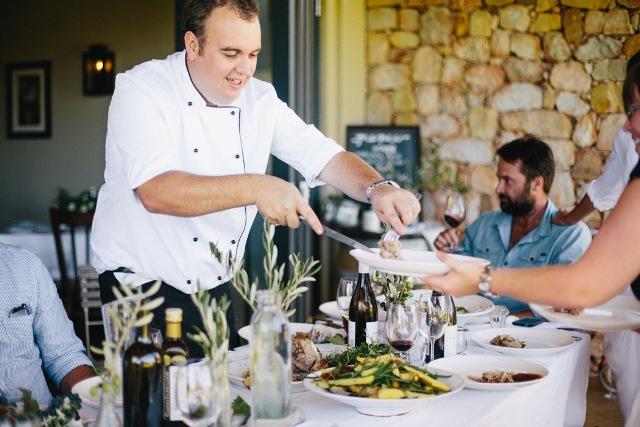 Chef Frans Groenewald dishing up at the table: Gabriëlskloof Sharing Sundays lunch. Photo Random Hat PR. Photographer Tasha Seccombe
